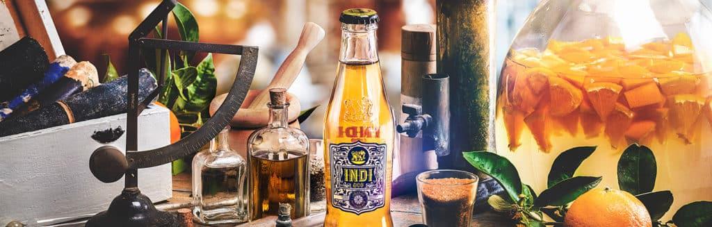 Montaje Soft Drinks con refresco de naranja de Indi